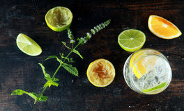 Fresh Lemons and Lemon Water on Wooden Table Royalty Free Stock Images