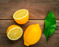 Fresh lemons and  lemons leaves on rustic wooden background. Fre Royalty Free Stock Photography