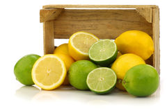 Fresh lemons and lime fruits and some cut ones Stock Photo