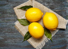 Fresh lemons on a linen napkin Royalty Free Stock Photos