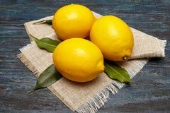 Fresh lemons on a linen napkin Royalty Free Stock Photography