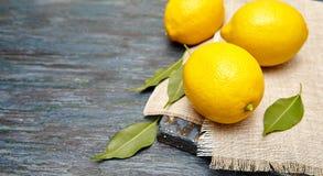 Fresh lemons on a linen napkin Stock Image
