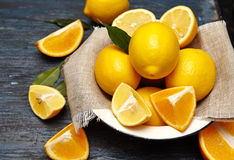 Fresh lemons and oranges in an old plate Royalty Free Stock Images