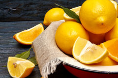 Fresh lemons and oranges in an old plate with linen napkin Stock Images