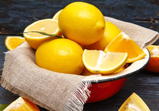 Fresh lemons and oranges in an old plate with linen napkin Royalty Free Stock Image