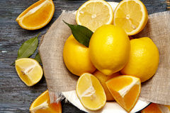 Fresh lemons and oranges in an old plate Royalty Free Stock Photos