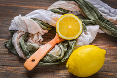 Fresh lemons on rustic wooden background. Stock Photos