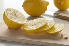 Fresh lemons and slices Royalty Free Stock Image