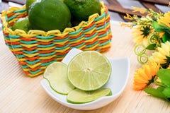 Fresh lemons slices. On white plate Stock Images