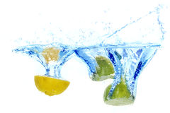 Fresh lemons splash into water Stock Photos