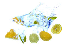 Fresh lemons splash into water Royalty Free Stock Photos