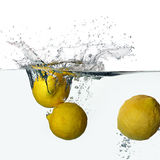 Fresh Lemons Splash in Water Isolated on White Background Stock Image