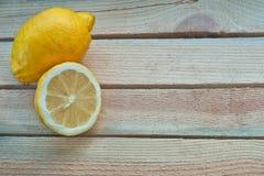 Fresh lemons. Still Life with 2 fresh  lemons on a wooden background Stock Images