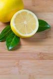 Fresh lemons on a table. Fresh lemons on a bamboo table, fruit rich in vitamin c Stock Photo
