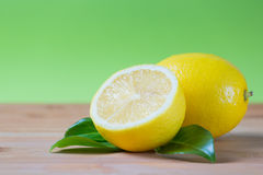 Fresh lemons on a table. Fresh lemons on a bamboo table, fruit rich in vitamin c Stock Photos