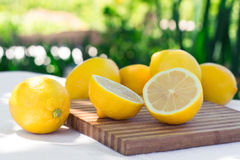 Fresh lemons on the table on natural background Stock Photos