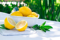Fresh lemons on the table in the open air. Selective focus. Stock Photo