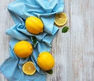 Fresh lemons on a table Stock Image