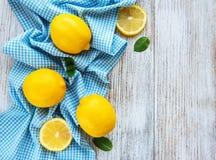 Fresh lemons on a table. Fresh lemons on a white wooden table royalty free stock images