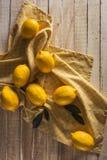 Lemons. Fresh lemons with tablecloth on wooden tabletop Stock Photo