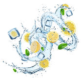 Fresh lemons with water splash. Royalty Free Stock Photo
