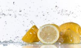 Fresh lemons with water splash Stock Photography