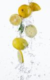 Fresh lemons with water splash Stock Images
