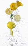 Fresh lemons with water splash Stock Images