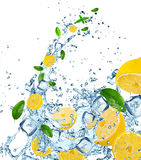 Fresh lemons in water splash. Royalty Free Stock Photography