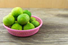 Fresh lemons on wooden background. Selective focus. Royalty Free Stock Photos