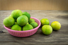 Fresh lemons on wooden background. Selective focus. Royalty Free Stock Photo