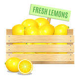 Fresh lemons in a wooden box on a white background. Vector icon. Royalty Free Stock Image