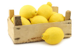 Fresh lemons in a wooden crate Royalty Free Stock Images
