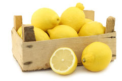 Fresh lemons in a wooden crate Royalty Free Stock Photos