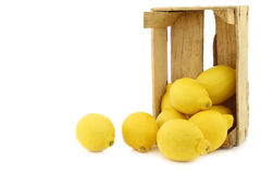 Fresh lemons in a wooden crate Stock Photography