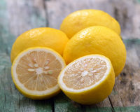 Fresh lemons on wooden table Royalty Free Stock Photography
