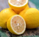Fresh lemons on wooden table Royalty Free Stock Photos