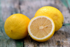 Fresh lemons on wooden table Stock Photos