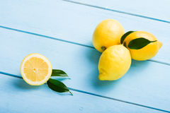 Fresh lemons on wooden table Royalty Free Stock Image