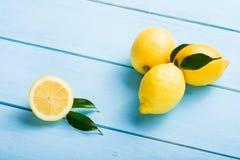 Fresh lemons on wooden table Royalty Free Stock Image