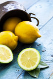 Fresh lemons on wooden table Stock Images