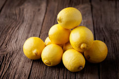 Fresh lemons on a wooden table Stock Photo