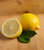 Fresh lemons on wooden table Stock Photography