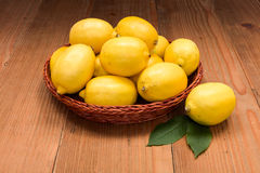 Fresh lemons in wooden tray Royalty Free Stock Image
