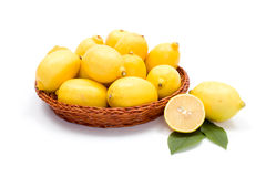 Fresh lemons in wooden tray Stock Photography