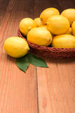 Fresh lemons in wooden tray Royalty Free Stock Images