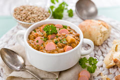 Fresh lentil stew with sausages Stock Image