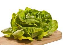 Fresh lettuce. Fresh little gem lettuce on a wooden cutting board Royalty Free Stock Photos