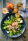 Fresh lettuce with addition of pear, blue cheese and caramelized walnuts Royalty Free Stock Photography