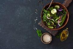 Fresh Lettuce, Arugula, Frisee, Basil, Cucumber And Onions Salad Royalty Free Stock Photography